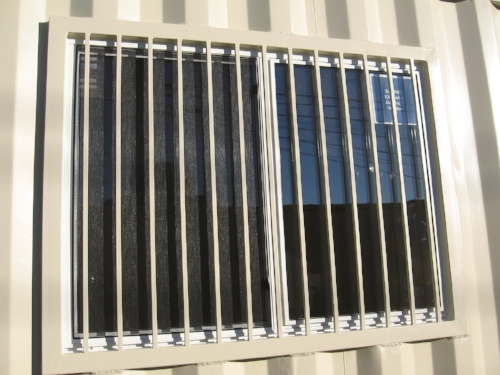 "36"" X 48"" Double pane window with security bars"