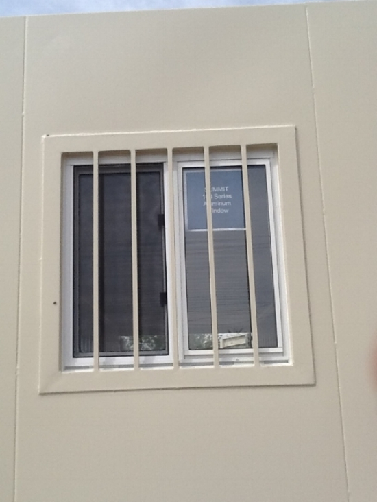 "24"" X 24"" Double pane window with security bars"