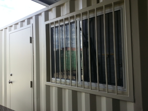 Side door and large window best installed on a work shop or office space.