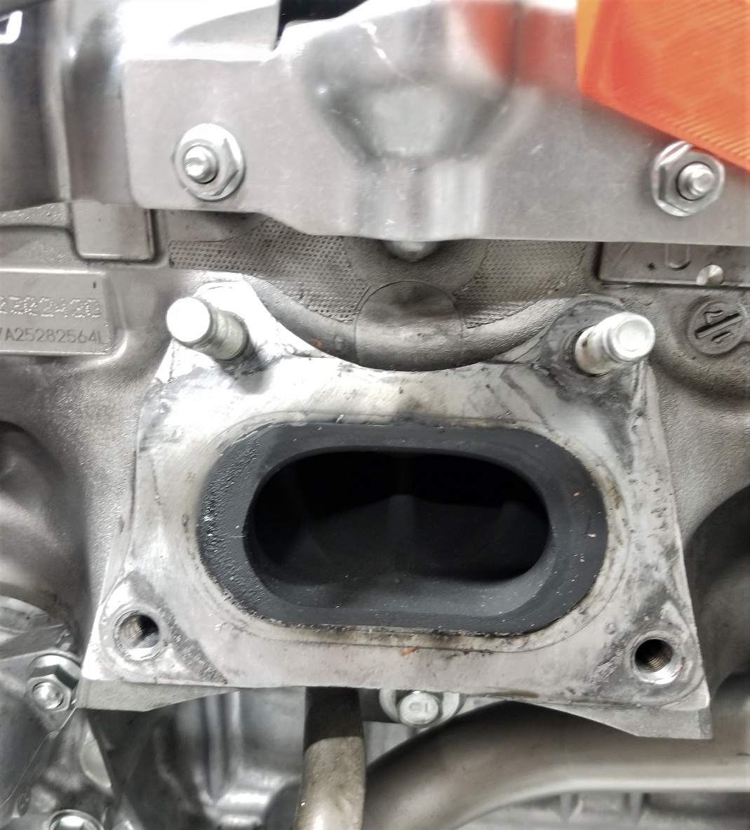 The single exit exhaust port on an L15 engine, The turbocharger mounts directly to the cylinder head here