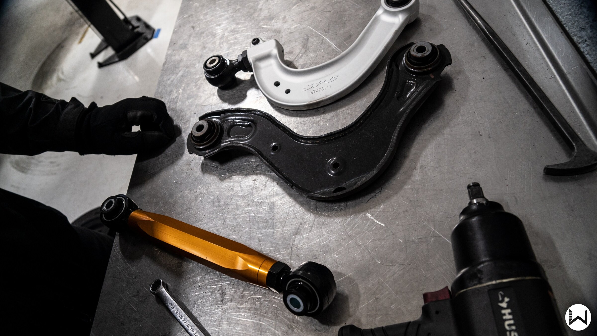 OEM Camber arm next to SPC Camber Arm