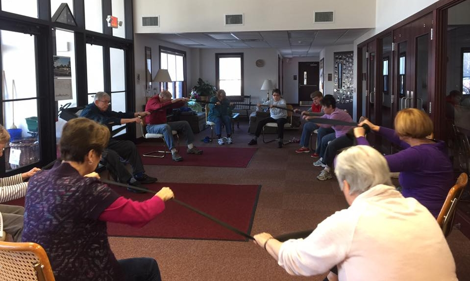 An exercise class in the Narthex, with the front doors on the left