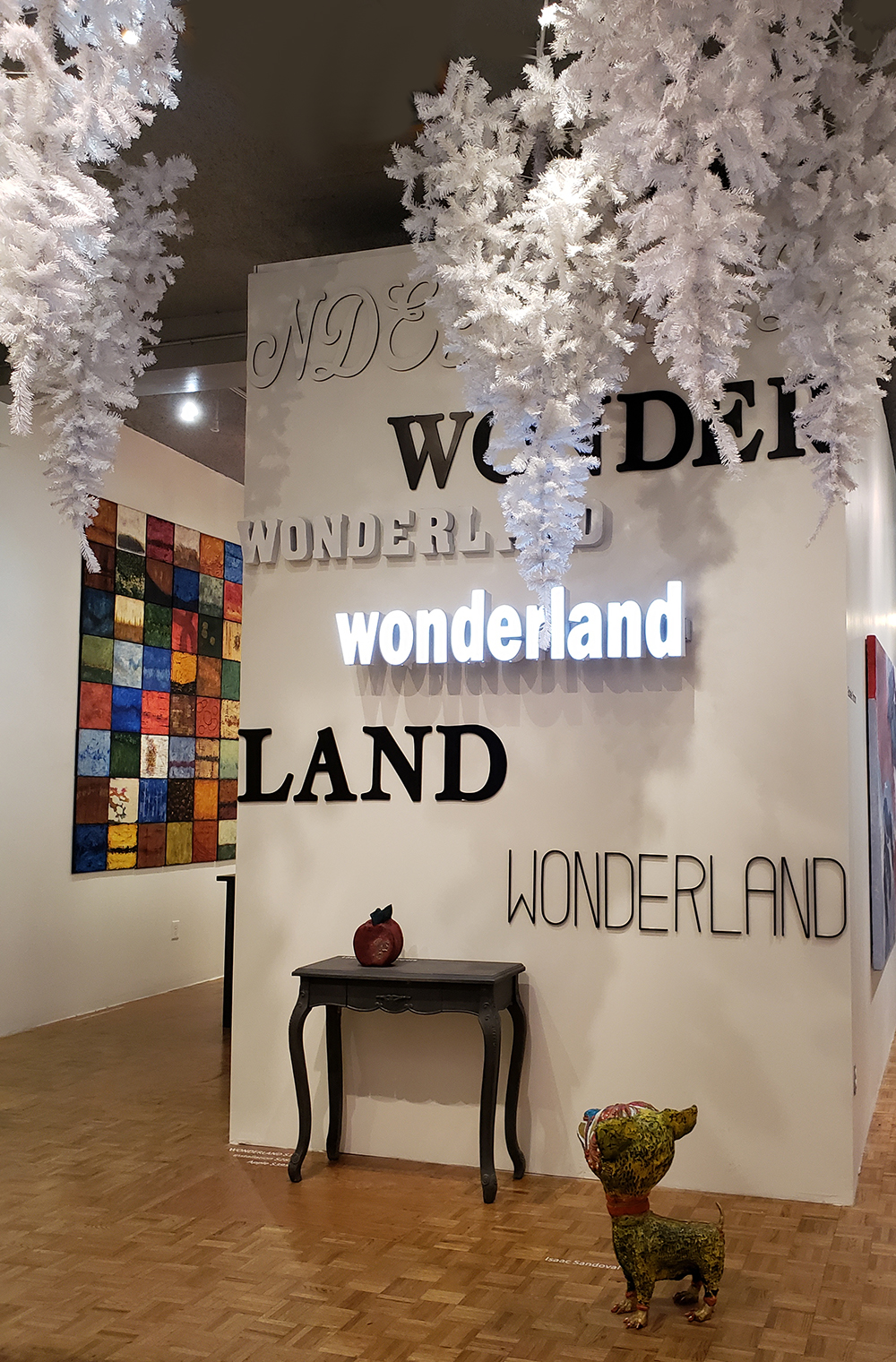 Wonderland, Laura Phelps Rogers, - Patricia Martin works in background and Isaac Sandoval (dog) in foreground.jpg