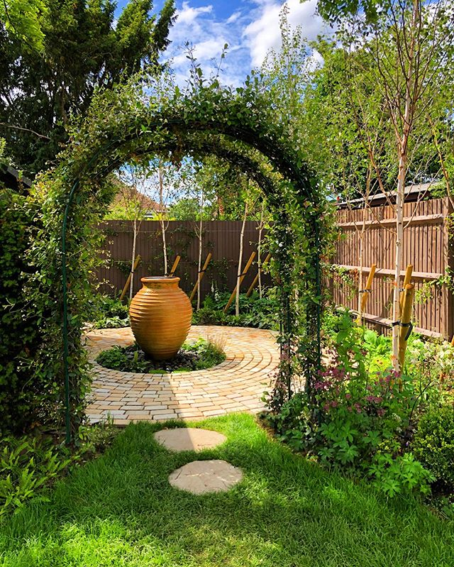 Visited the Molesey property today, the garden was so vibrant in the ☀️ sunshine. I love the view into the woodland garden at the bottom and the site of the lovely overflowing urn cascading water onto the pebbles below. My design style is normally a lot more contemporary than this but it was lovely to work for clients who wanted something more traditional and with a mass of planting. . . . #newproject #gardendesign #cathowardgardendesign #cathowardlandscapedesign #hamptoncourt #surrey #surreylife #waterfeature #oakpergola #perennialgarden #arch #jasmine #silverbirch