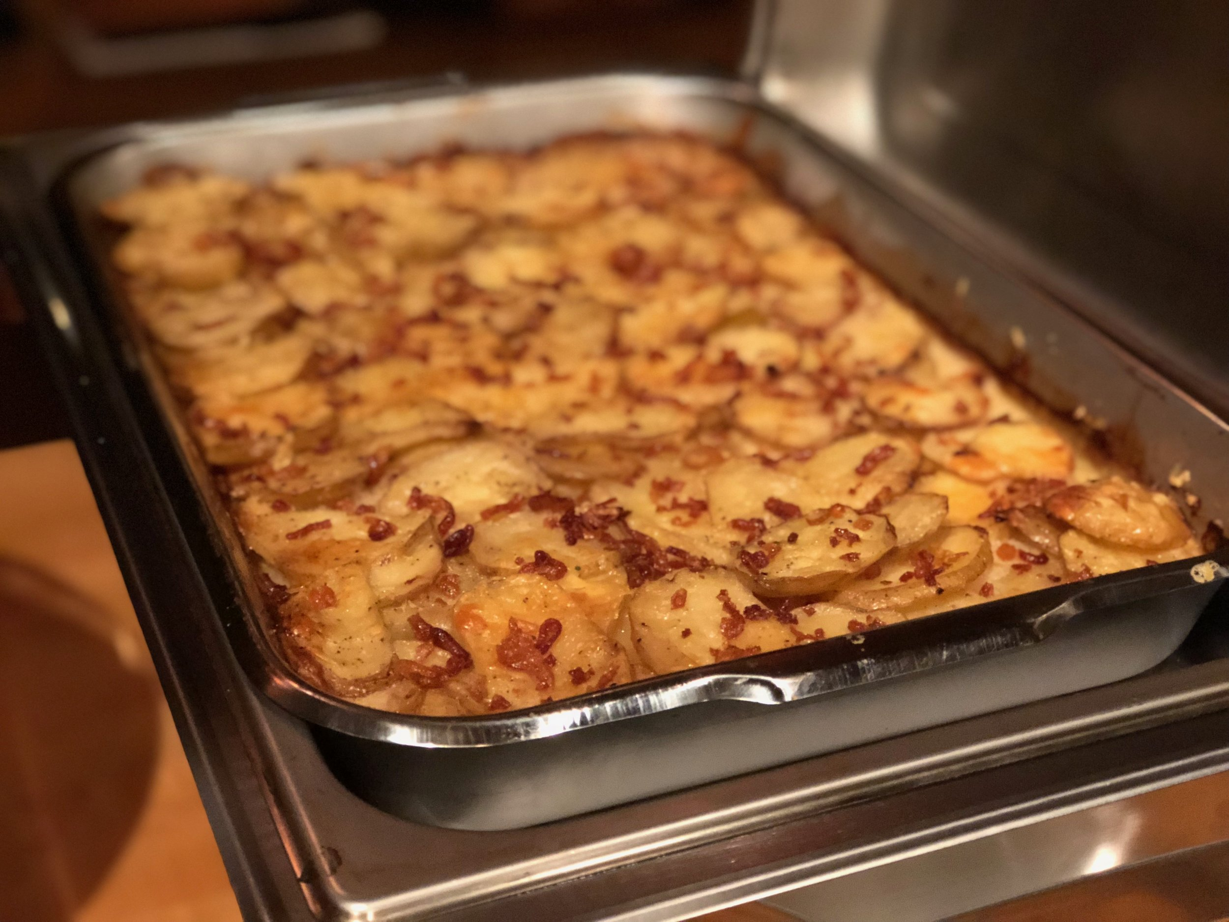Aged White Cheddar Scalloped Potatoes with Crispy Shallots