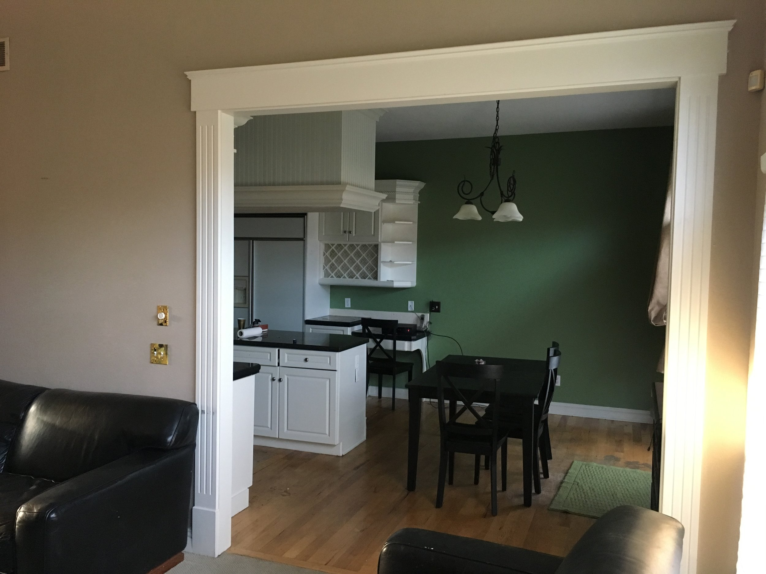 BEFORE-Overall lack of lighting and soffit above the island makes the kitchen appear much smaller than it is