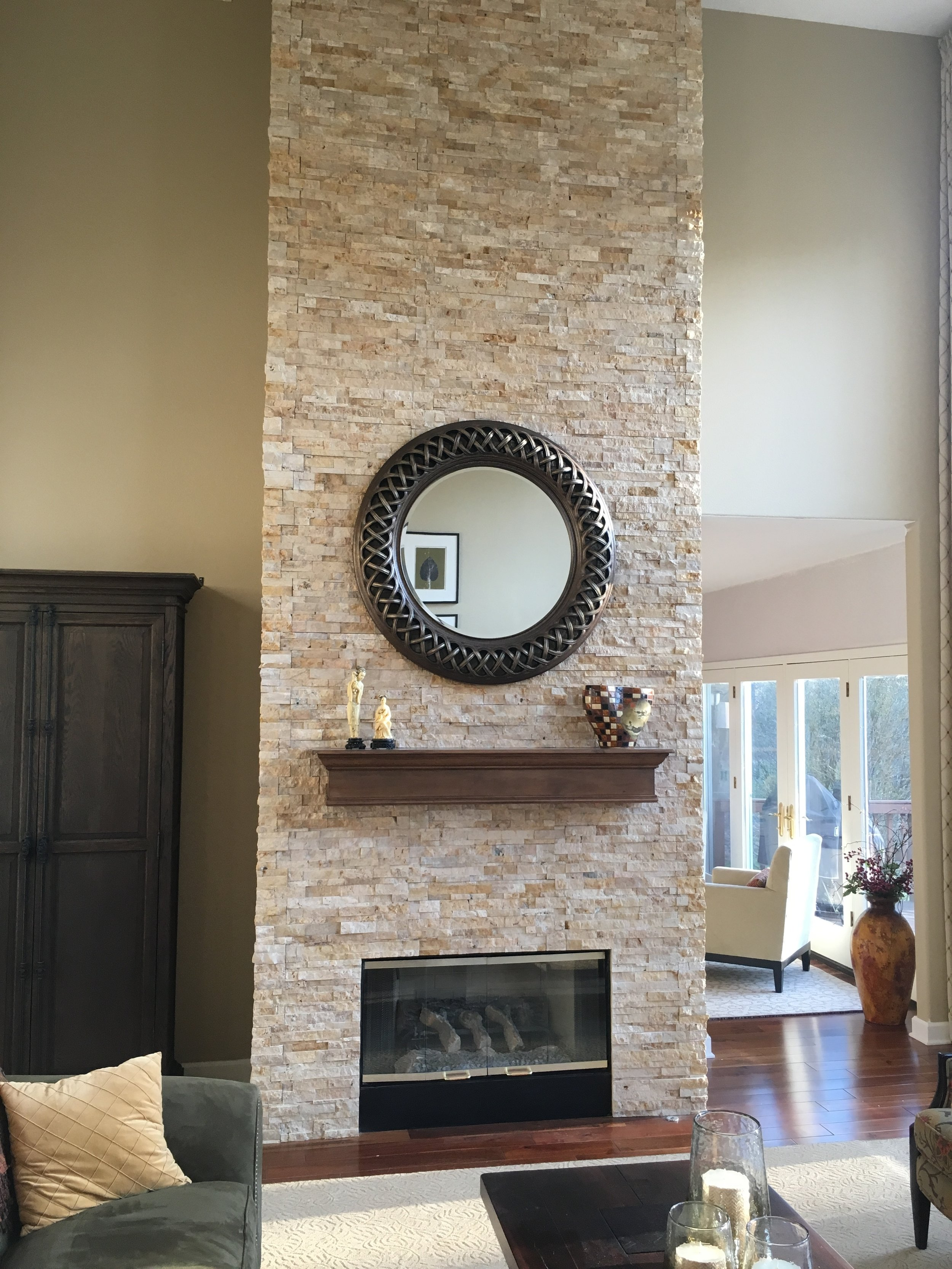 AFTER-a blank wall becomes a showpiece with an overlay of custom stone work