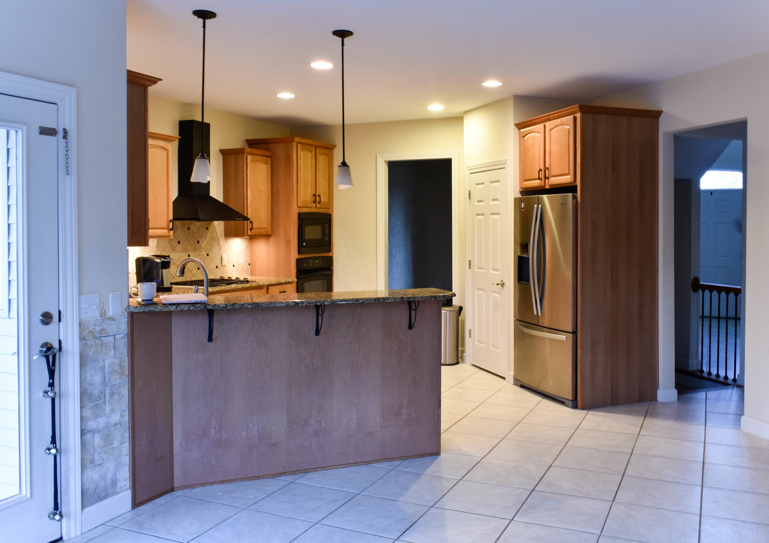 BEFORE-A lack of counter space and lighting makes this kitchen a perfect candidate for a refresher
