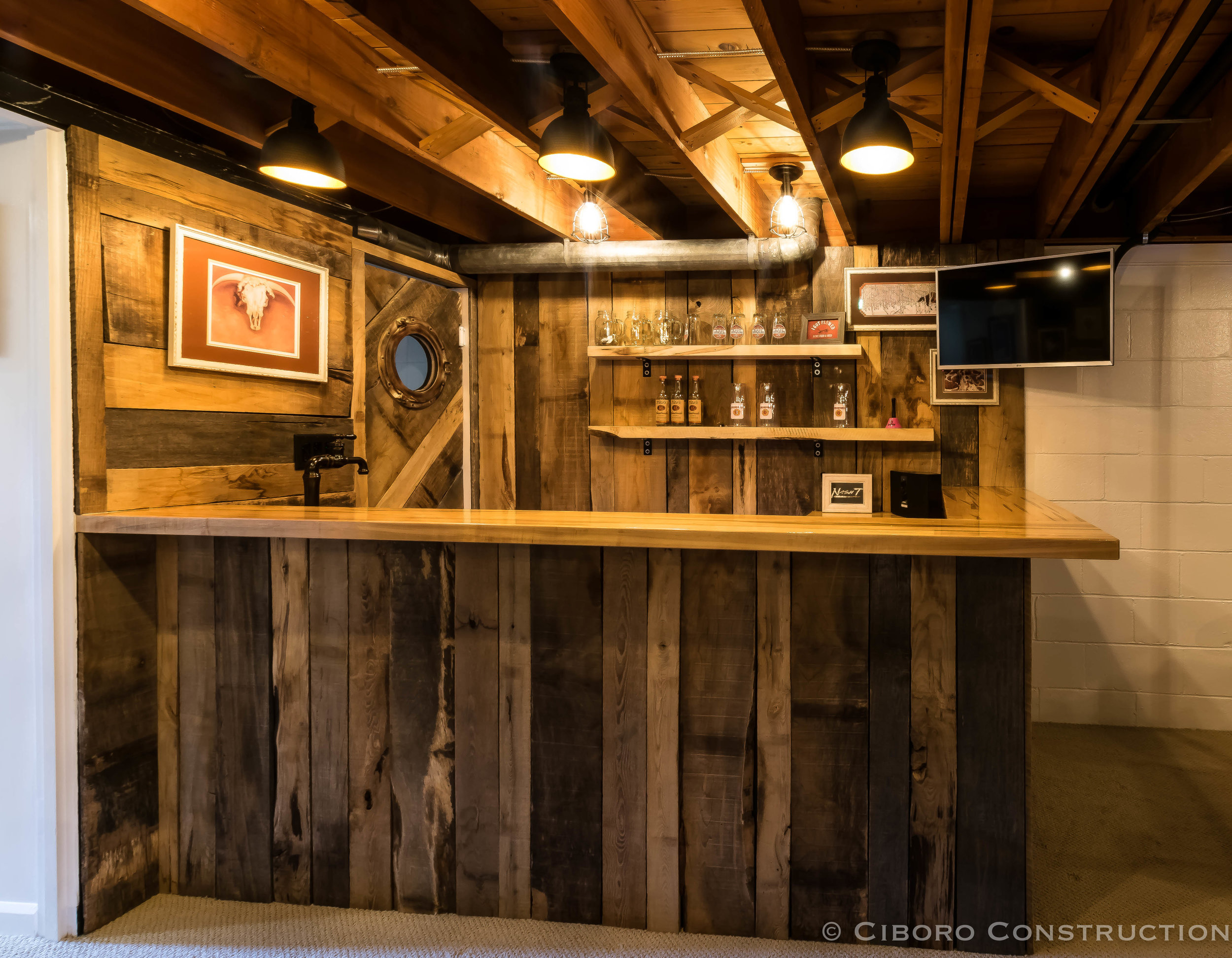 AFTER-Exposed ceiling beams and a custom bar change the feel of the space