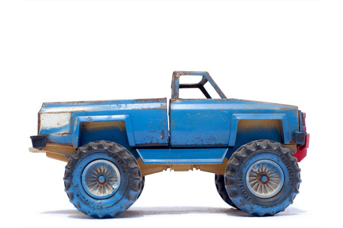 Vintage Toy Monster Truck in Blue Side View.jpg