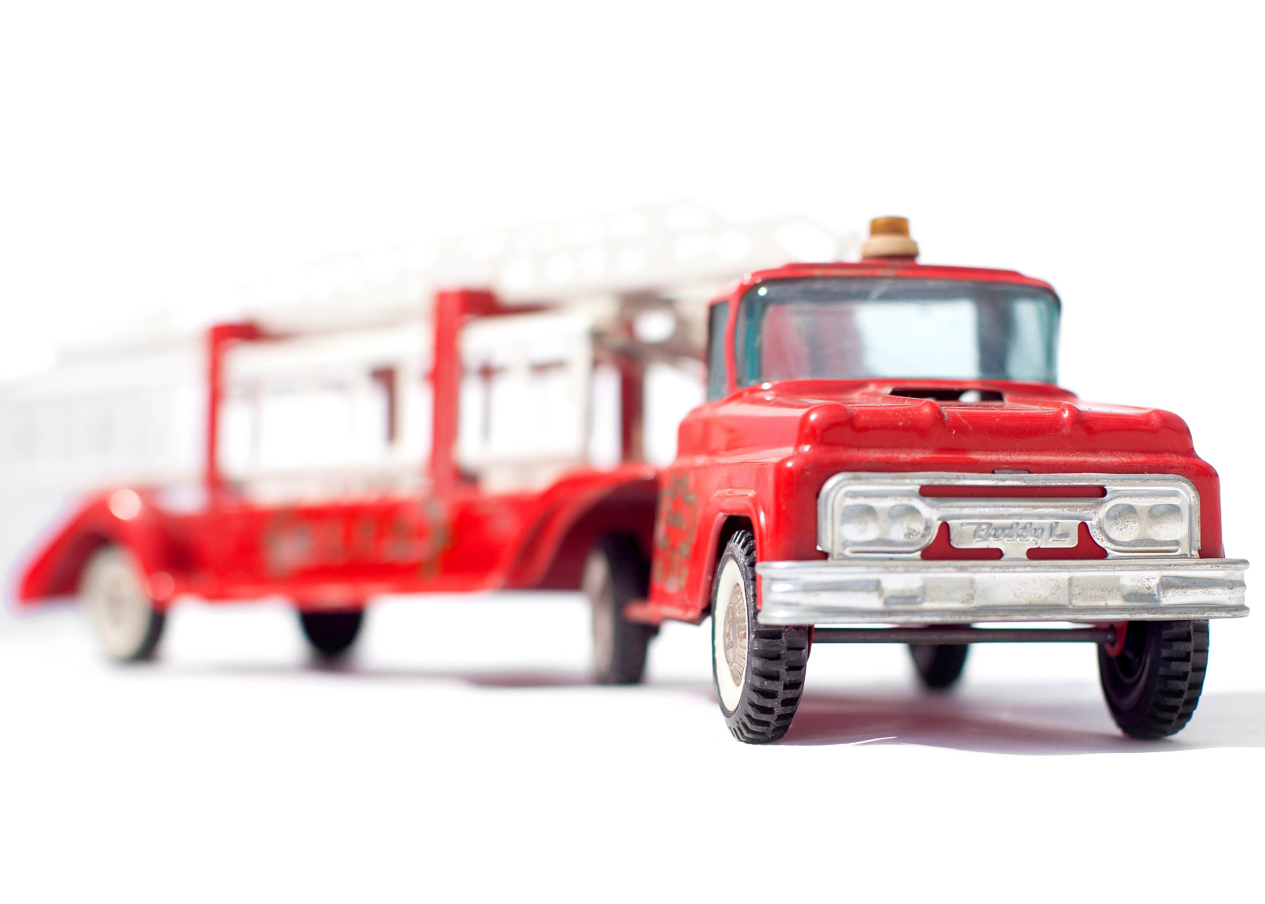 Vintage Red Toy Fire Truck Hook and Ladder Facing Front Right.jpg