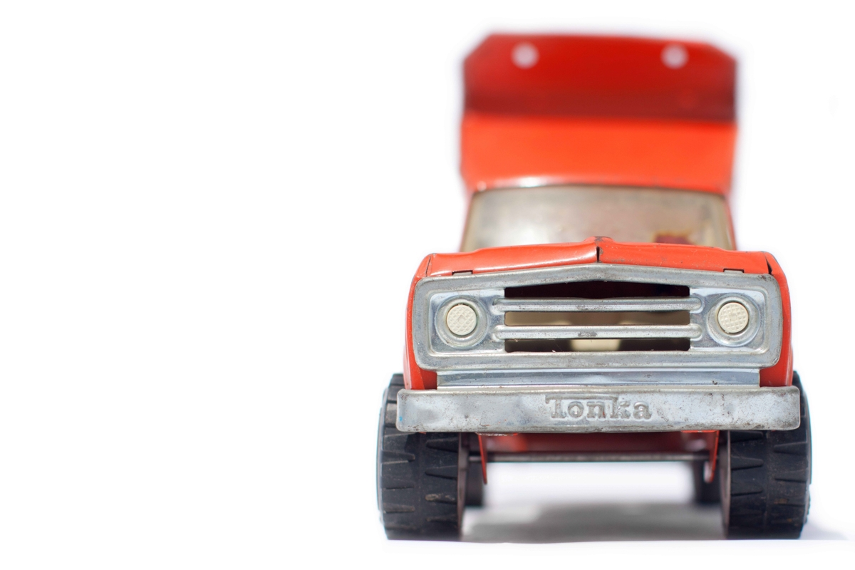 Vintage Ornage Toy Dump Truck Front View to the Right.jpg