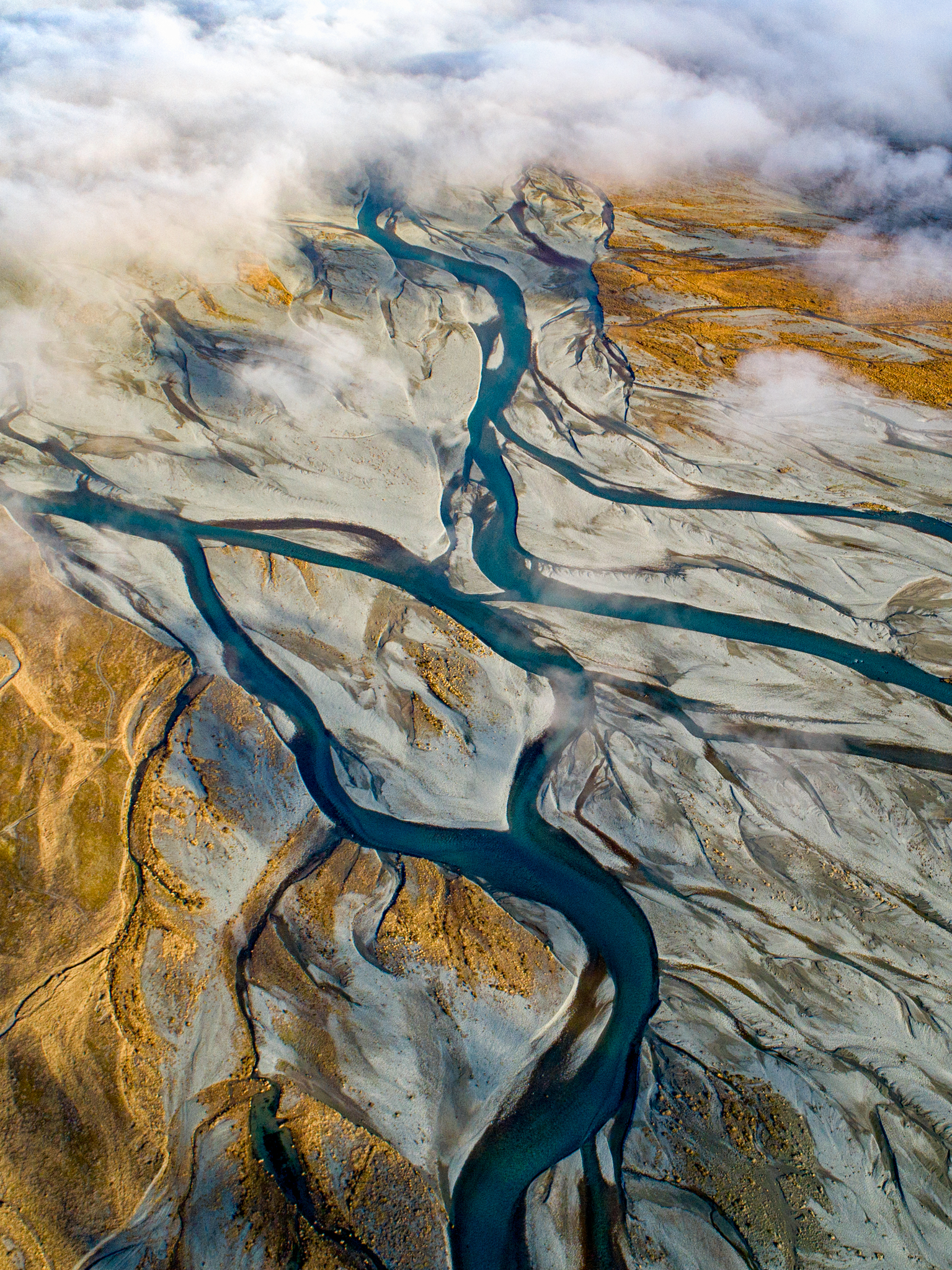 The Rangitata's flow emerges from its cloak of fog revealing the intricacies of the adventure it's on!(Talman Madsen)