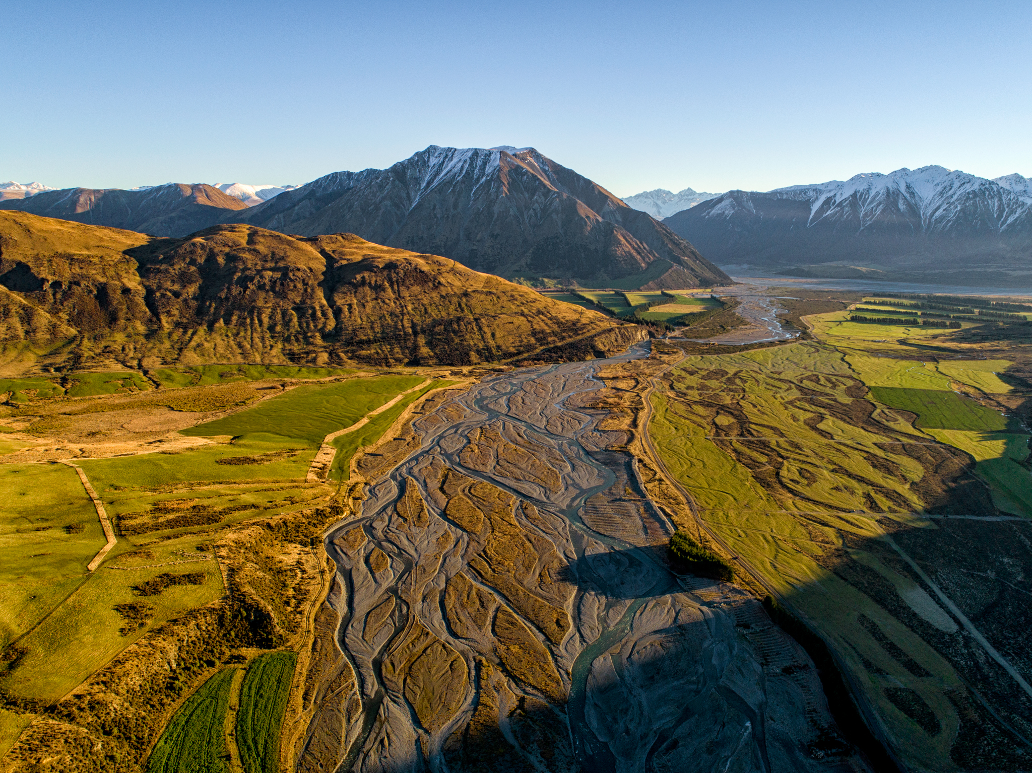 The Harper River dresses in gold as the sun's rays kiss it goodnight. (Talman Madsen)