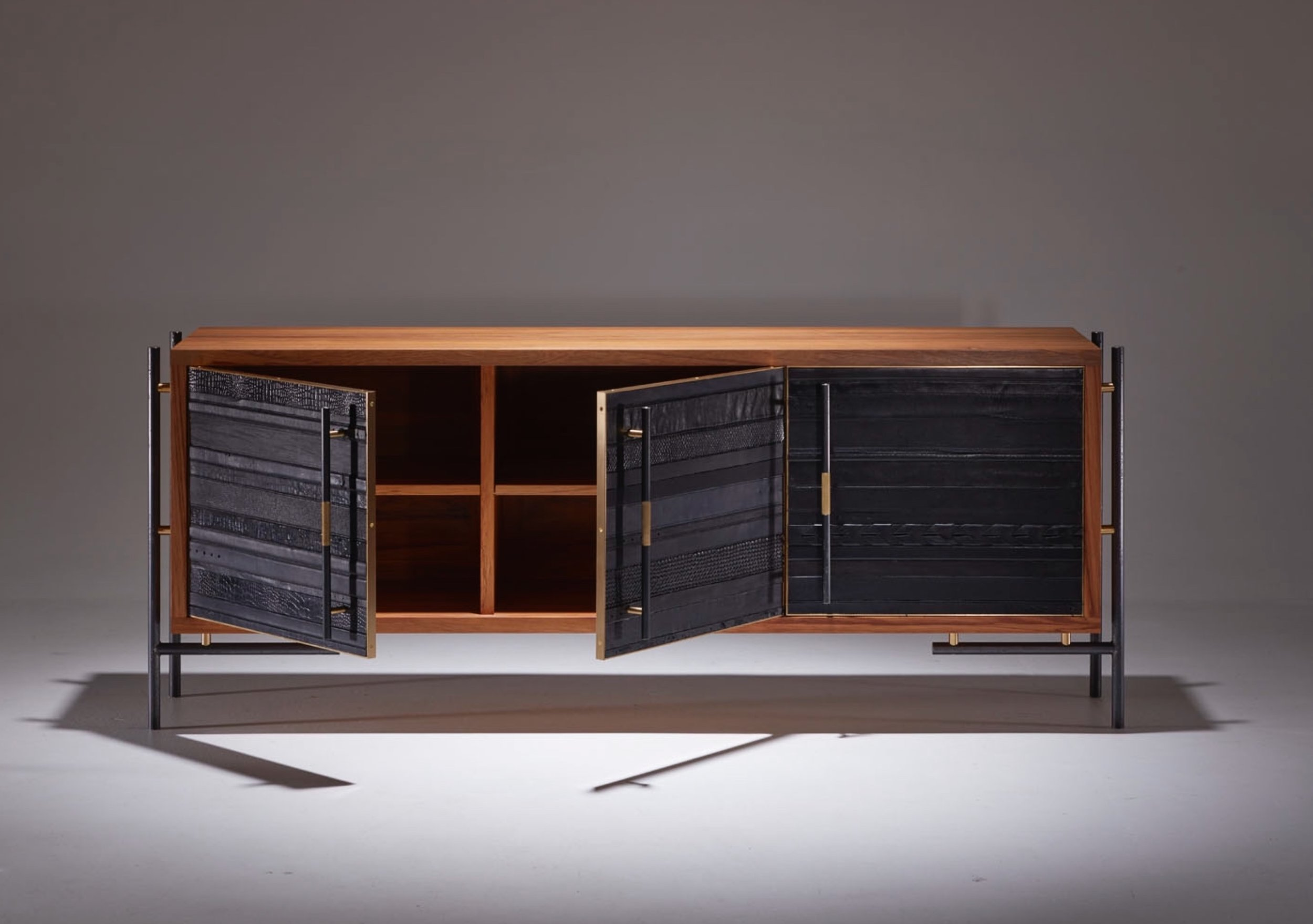 The ReLEATHERED Sideboard/Credenza. Used black leather belts, Rimu, blackened steel and polished brass.