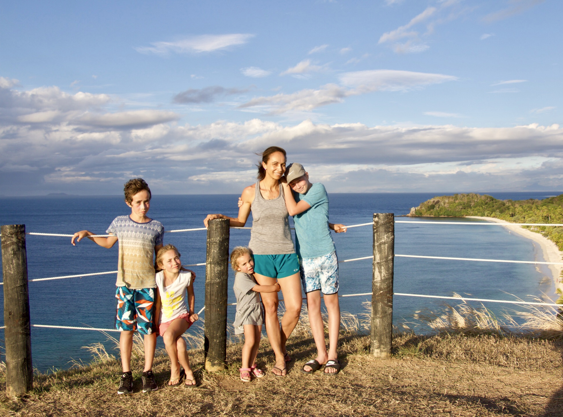Lyzadie, on holiday, travelling the world with her children.
