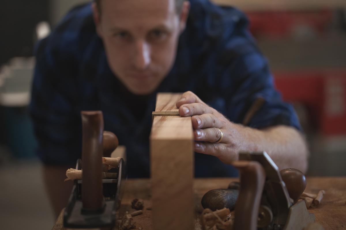Sam James from Sam James Furniture in the workshop in Tauranga making extraordinary beautiful furniture.