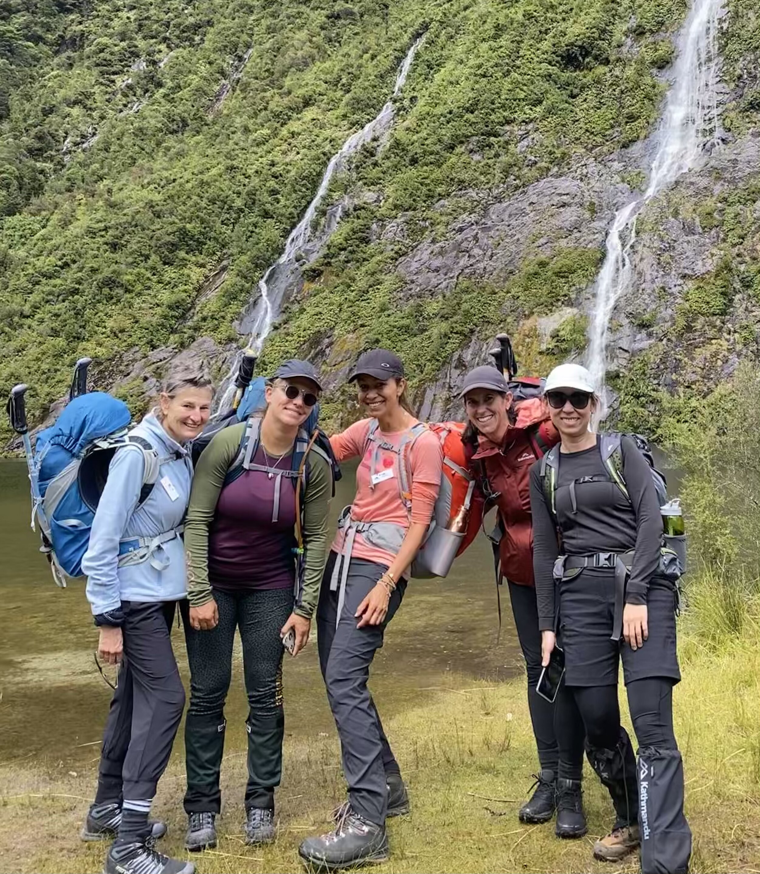Lyzadie (in the center), with new friends she met on that adventure,  on a 4 day hike deep in Fjordland National Park.