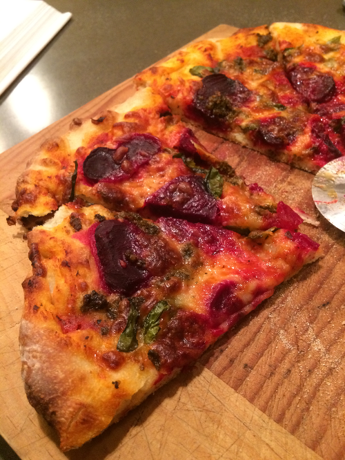 Beets and fresh basil top this pizza