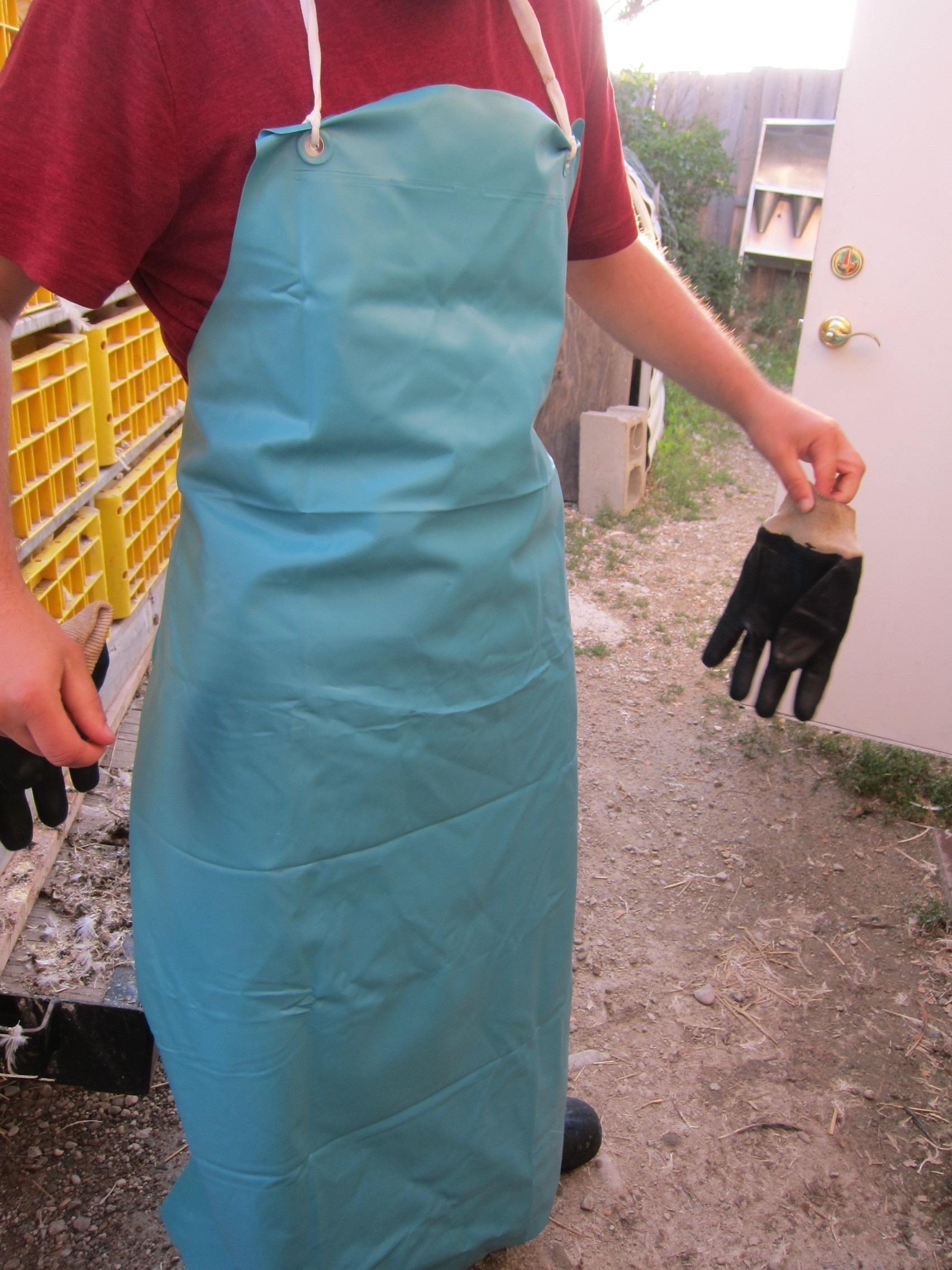 A worker showing off his rubber apron. I wish I had these for processing at home!