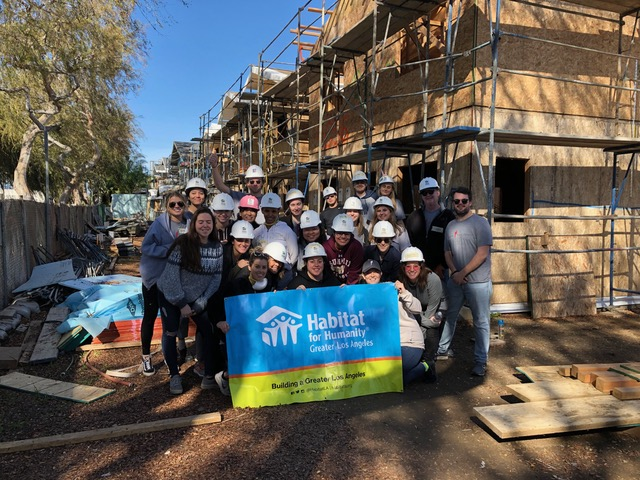 Denise and the Paradigm team volunteering with Habitat for Humanity.