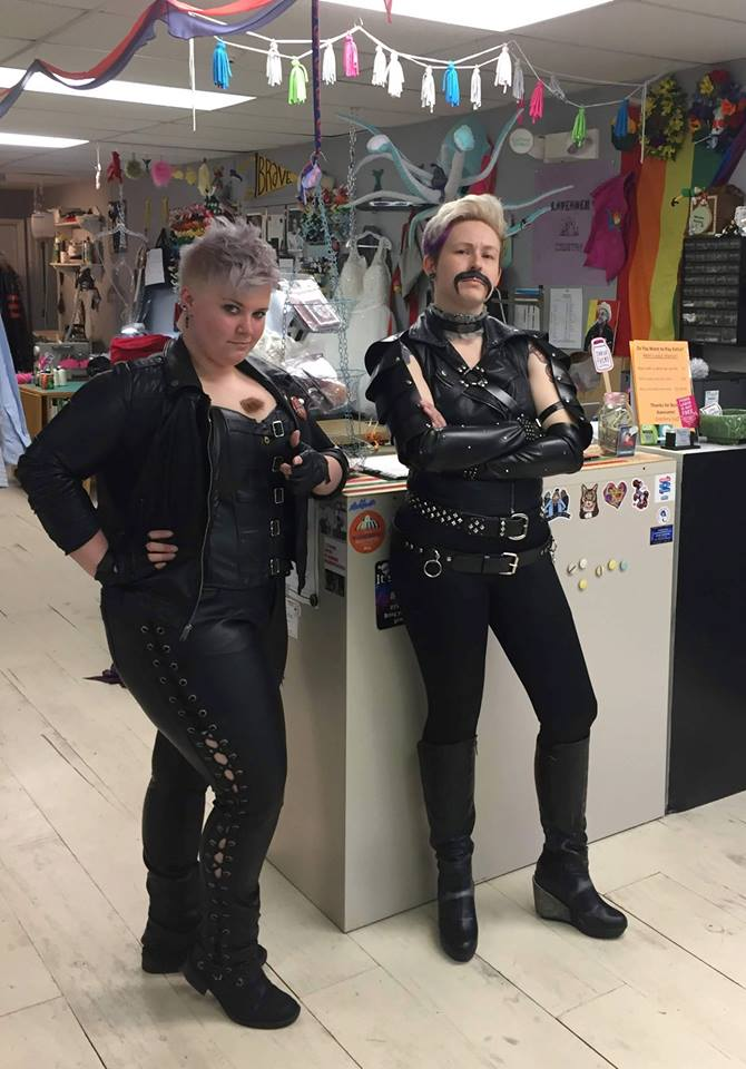 Miranda and Liby pose as the winners of Bloomington's Best Leather Repair Shop (we don't actually repair leather, so we did our best).