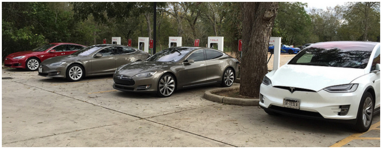 Four Tesla Electric Vehicles at Columbus, Texas, Supercharger.    Ed Uthman   , Flickr
