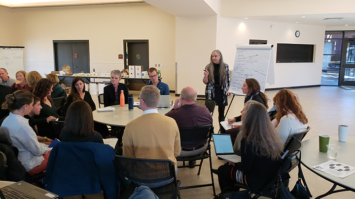 Colorado Energy Office's Maria Eisemann facilitates a working group discussion aimed at advancing clean transportation solutions.