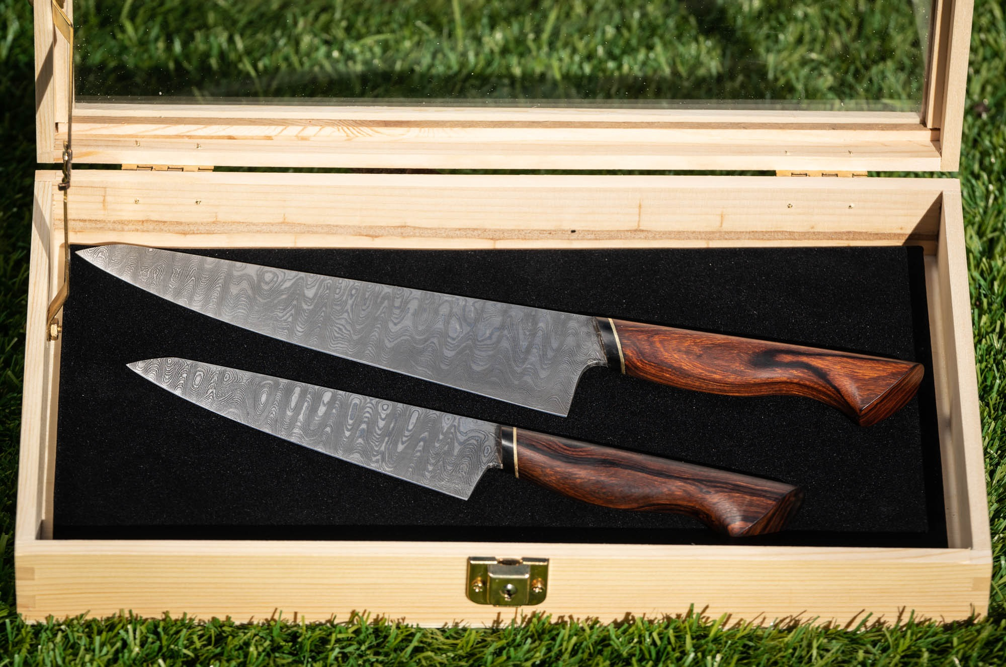 """- Paired 8"""" Chef's and 6"""" Utility. Damascus blades and ironwood burl handles. Build Price $650. Case not included."""