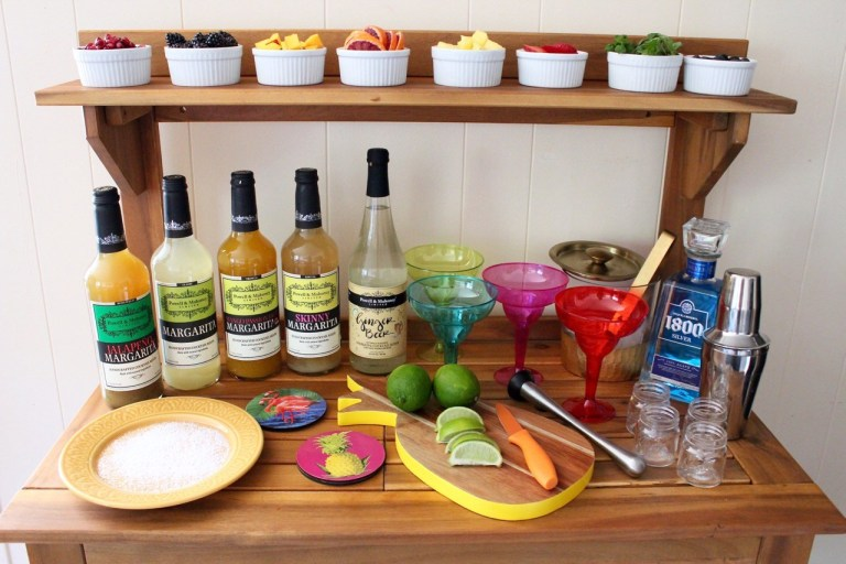 "So we aren't sure if this falls into the decoration category, but the way Whitney Bond has set up her ""DIY Margarita Bar"" we think it counts! We love the idea of letting your guests be their own bartenders because then you aren't stuck (wo)manning the blender all day! If your guests aren't drinking then make sure to add a few extra fruit juices or sparkling water options to keep things interesting. Plus, we think our  Margarita glasses  would showcase your guests' creations perfectly."