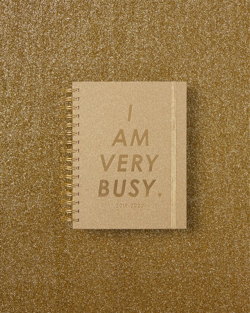 PLANtastic! - Whether it's boozy brunches or board meetings, this gold glitter,17-month planner from band.do is a stylish and fun way to keep your grad organized. $28 USD