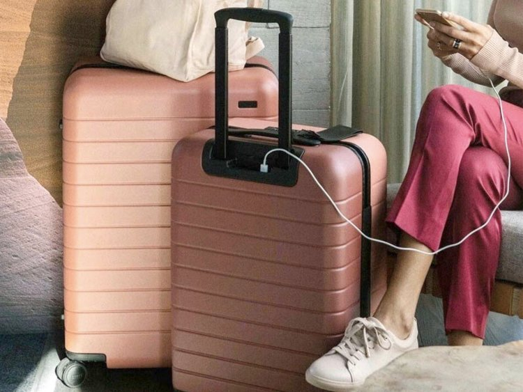 Travel Smart - This carry on suitcase from Away is sleek, modern, and comes with an optional ejectable battery to keep your grad charged up away from home. $225 USD