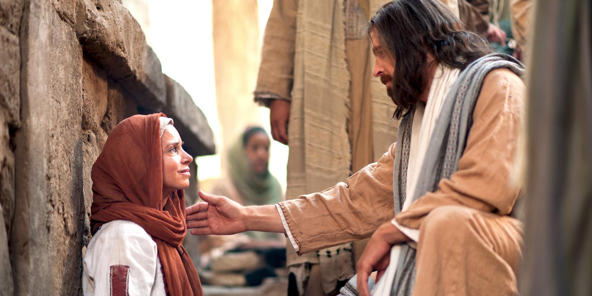 heals a woman of faith