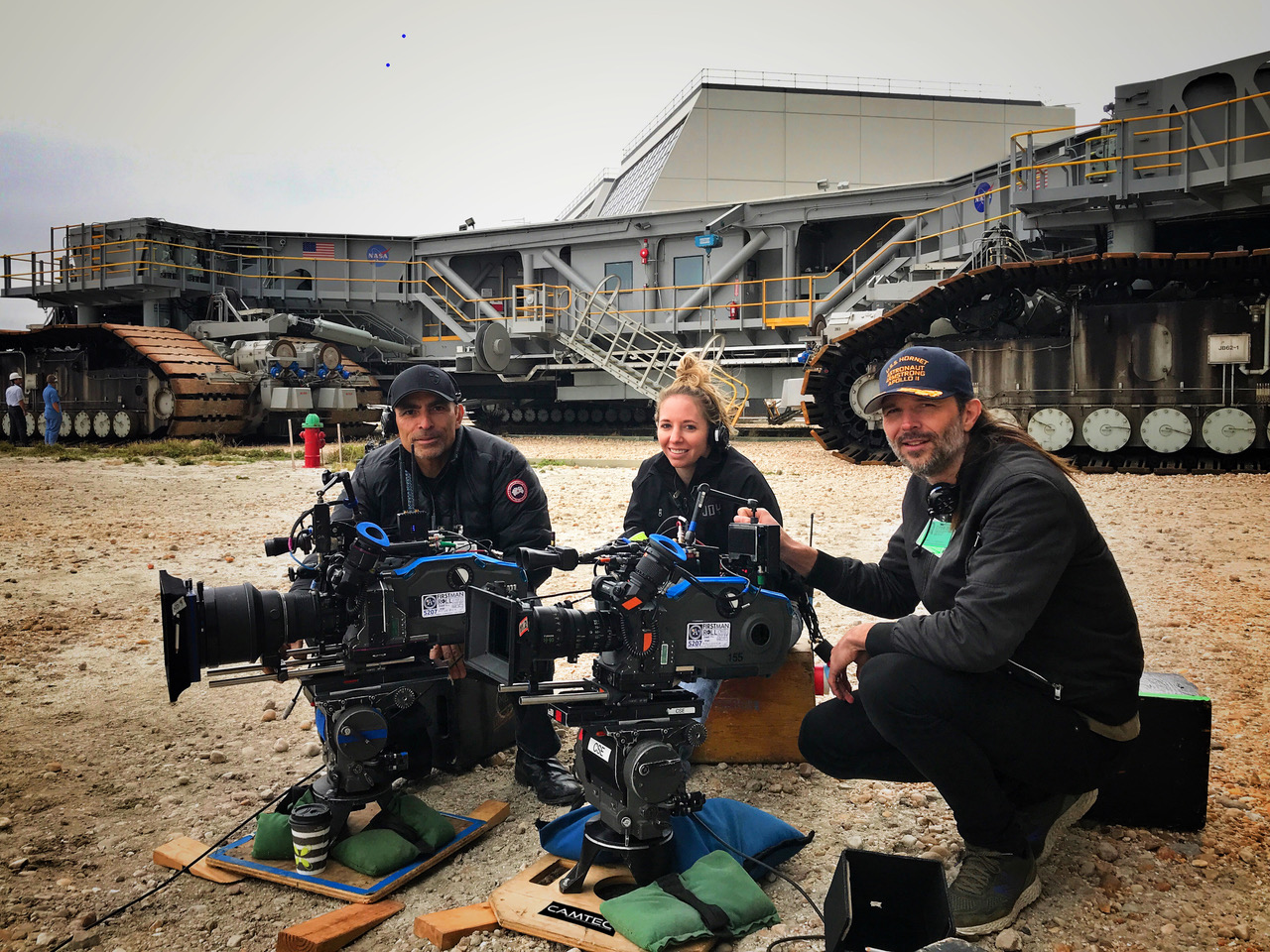(Left to right) 1st AC Jorge Sanchez, 2nd AC Melissa Fisher, and DP Linus Sandgren, on location for  First Man  with two Aaton Penelope 35mm cameras.
