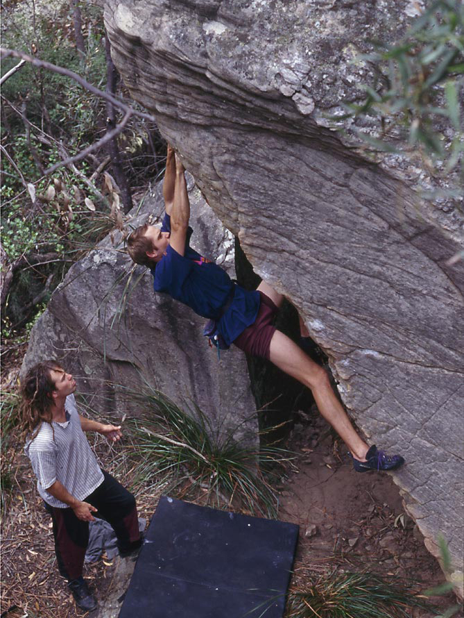 Doug Hockly spotted by an earlier-model Dave Jones during an early ascent of Bleausard (V5).  Image Doug Hockly collection