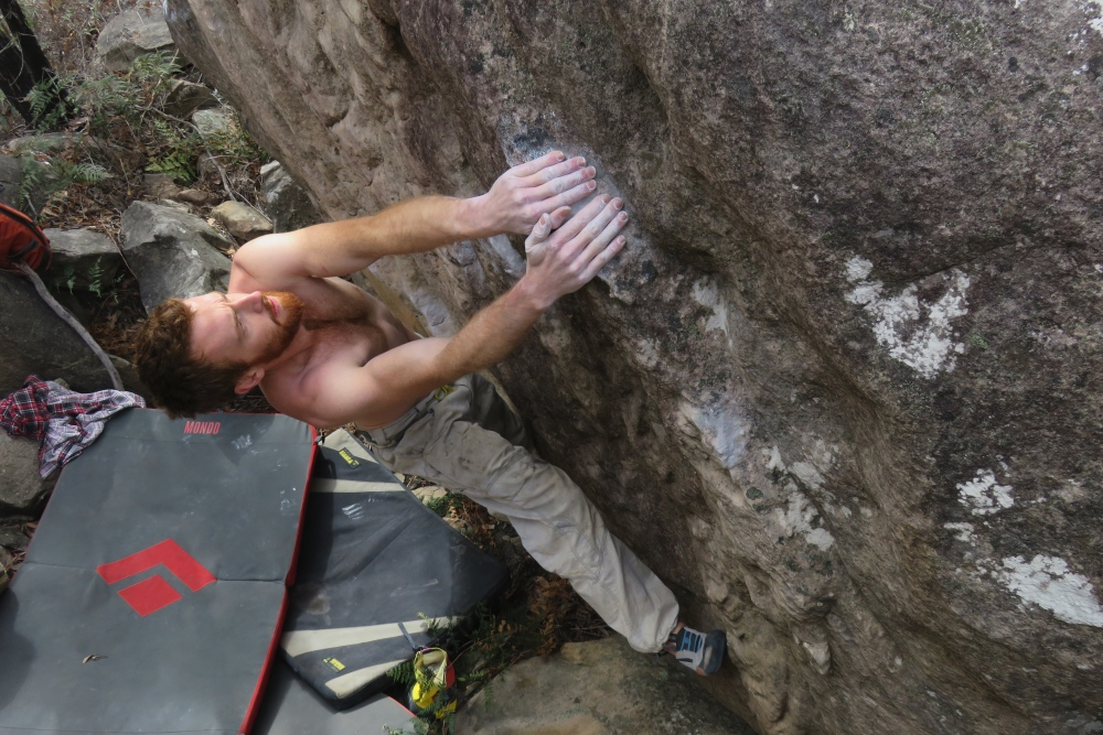 Oliver on the first ascent of Ways of Being (V11) at the Valley of the Giants. Matt Corbishley