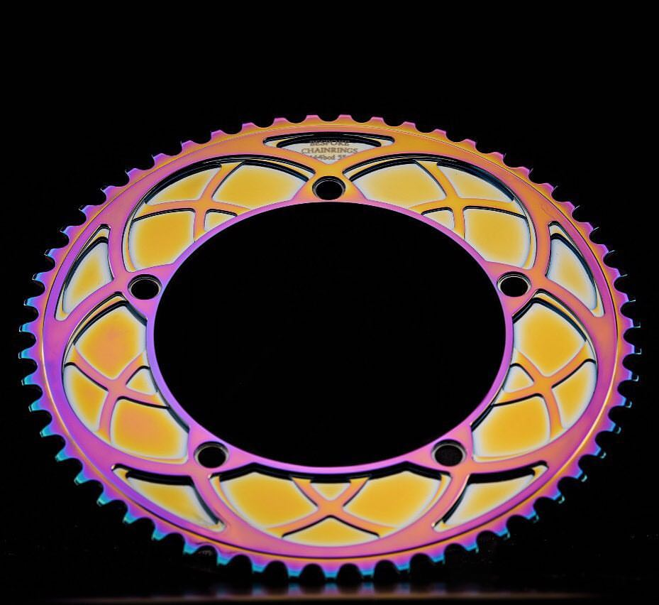 Bespoke Chainrings Stealth Rose 'Arches' chainring photographed by @drewkaplanphotography 👌🙌 All the colours of the rainbow - and performance too!! #bespokechainrings #stealthrose #arches  #track #chainring #rainbowchainring #bikeporn