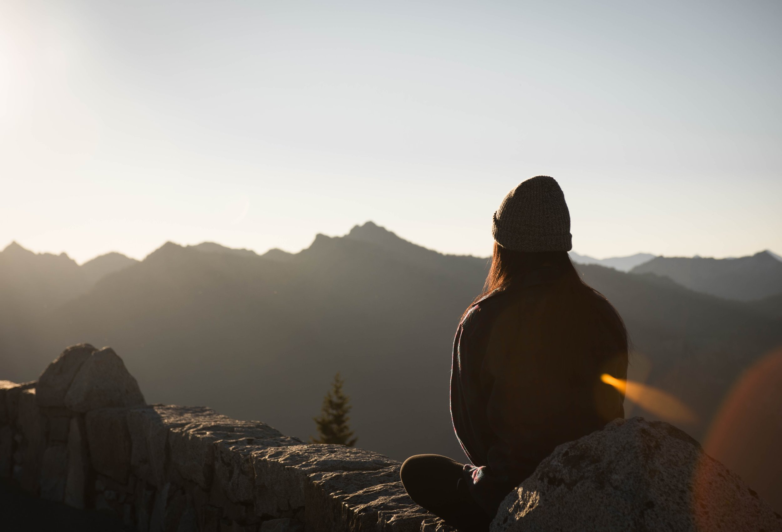 Girl looking out over mountains
