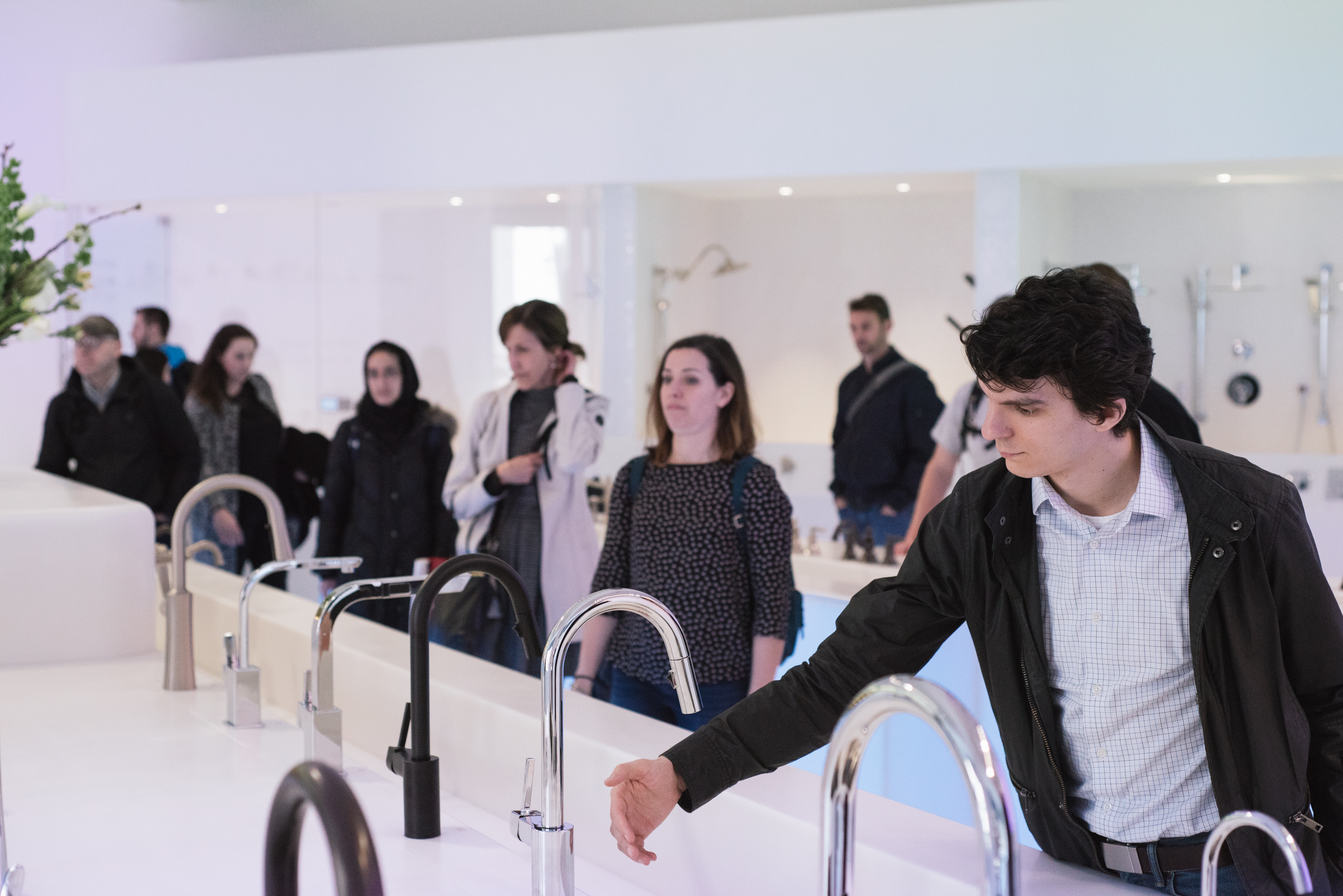 Zach tests an Align Kitchen Faucet at the Moen showroom