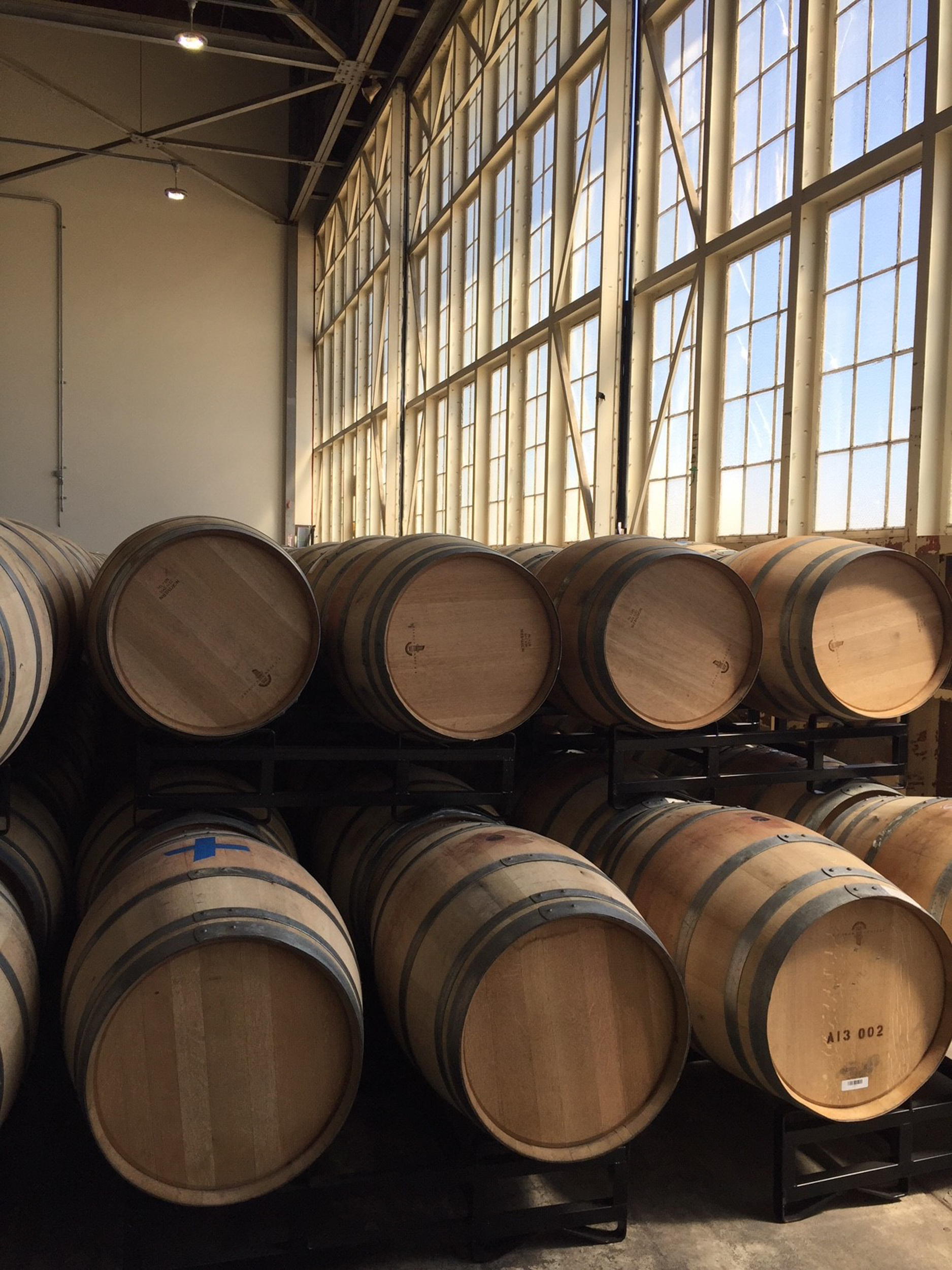 Oak barrels stacked at Hangar 1 Distillery