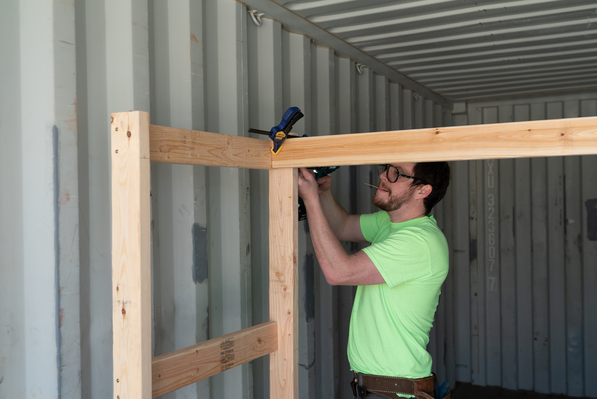 Stephen helps build out shipping containers for bike rentals and storage.