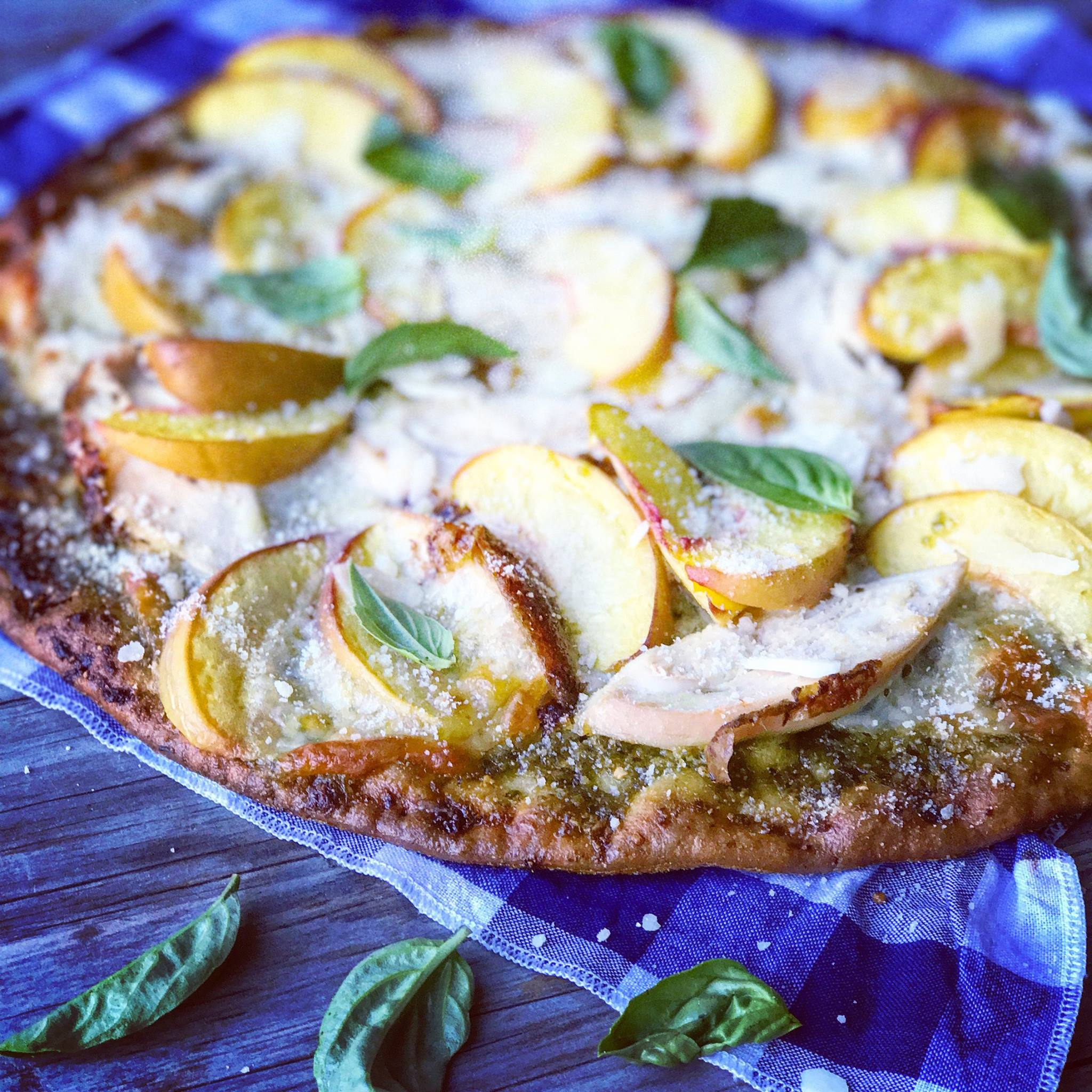 Peaches and provolone pizza with mango orange marinade