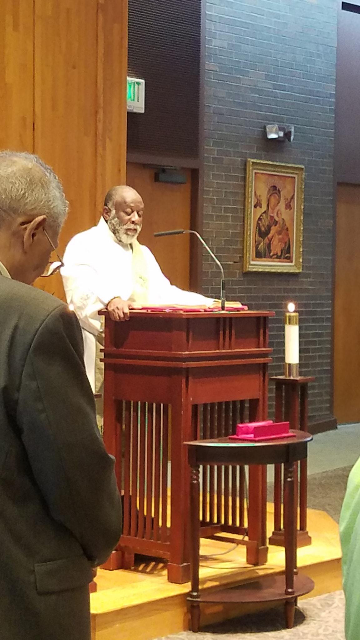 Deacon Paul proclaiming the word @ St. John's