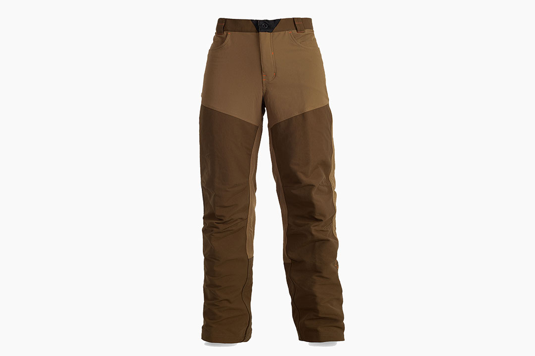First Lite Sawbuck brush pant - Finally a replacement for the old denim field pants he refuses to give up. With its four-way stretch nylon and reinforced two-layer chap panels, the Sawbuck Brush Pant provides true mobility and protection on the prairie or in the grouse woods.