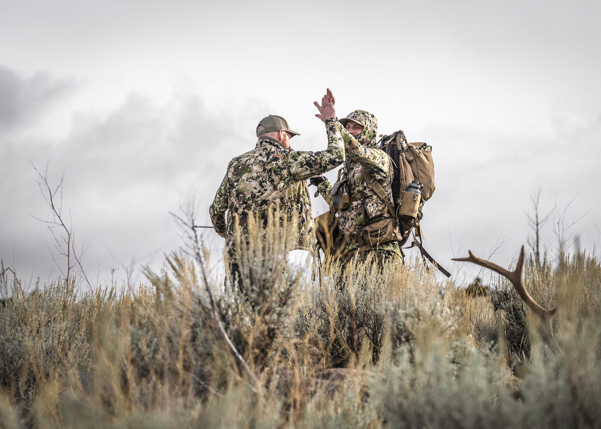 Casey Harbertson  of MTN Ops celebrates a successful harvest with  Garrett Hilbert .