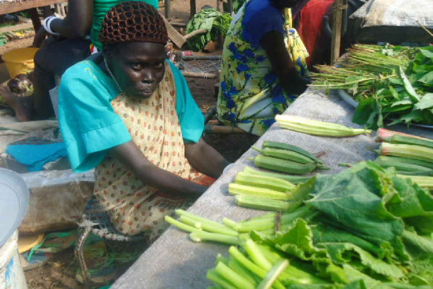 Kondok sells vegetables at a market stall in South Sudan as part of her new business.