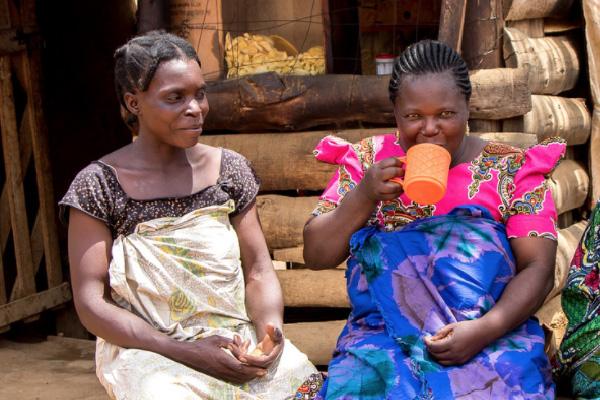 Enjoying chai outside a small business in Isopilo, Tanzania
