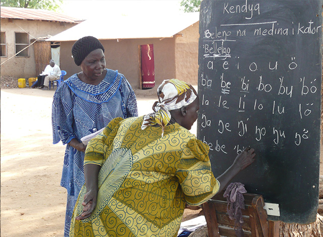 Women learn to read and write in their native languages as the first step in business development.