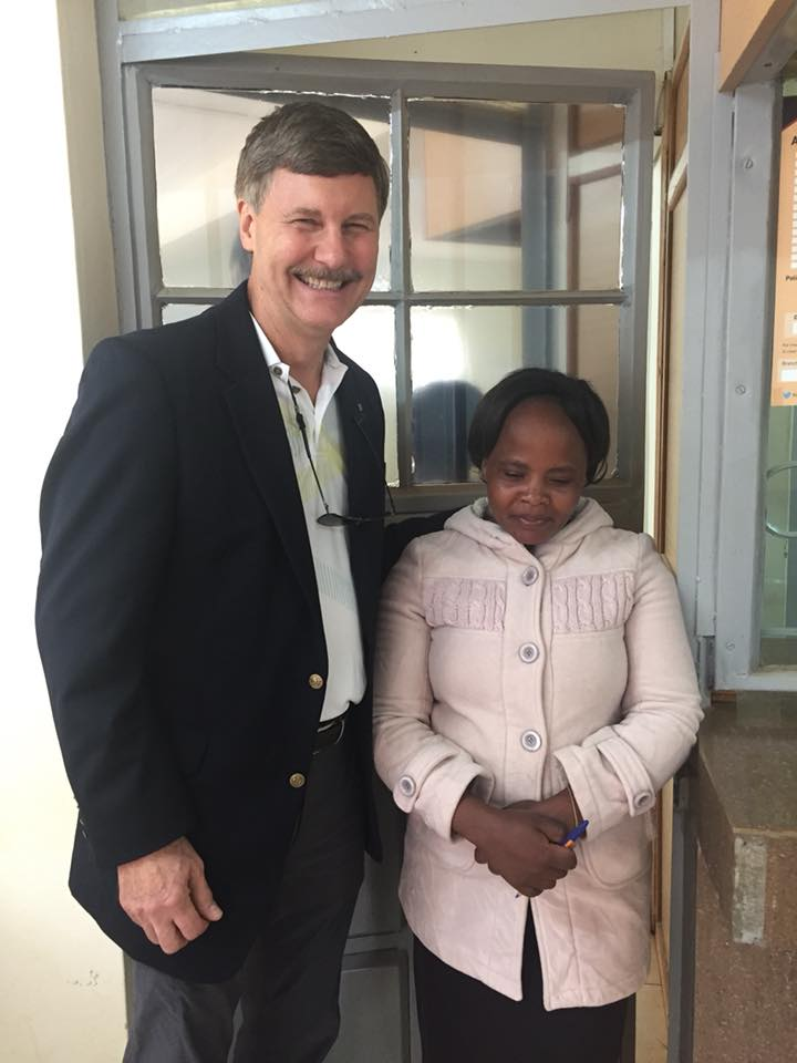 Dale with Ruth who manages a community bank established through assistance from Five Talents.