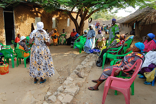 Above: Women gather during a savings group meeting in South Sudan.